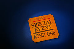 Event ticket. Stub in spotlight, on blue Royalty Free Stock Photos