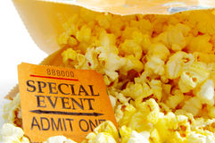 Event ticket. Special eventticket stub and bag of popcorn Royalty Free Stock Photos
