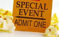 Event ticket. Special event ticket stub and popcorn  closeup Stock Photography