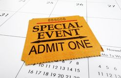 Event ticket stub. A closeup of a Special Event ticket stub on a calendar Royalty Free Stock Image