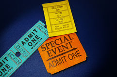 Event tickets. Assorted concert ticket stubs on blue Stock Photos