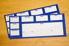 Event Tickets. Blank tickets for an event, lying on a table as background. Use for any design, simply add the copy you would like to see on the tickets Royalty Free Stock Images