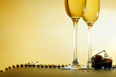 Event with two glasses and a necklace Royalty Free Stock Photo