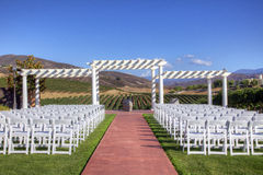 Event Venue with White Folding Chairs Stock Photo