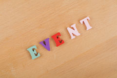 EVENT word on wooden background composed from colorful abc alphabet block wooden letters, copy space for ad text Stock Image
