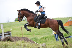 Eventer on horse is jump overcomes the fence Royalty Free Stock Photo