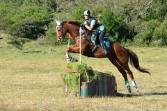Eventers jumping cross-country course Royalty Free Stock Photo
