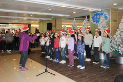 Evento do canto do Natal de Hong Kong Kids Foto de Stock