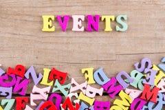 EVENTOS do texto 'de letras de madeira coloridas foto de stock royalty free