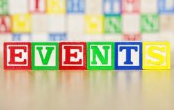 Eventos soletrados para fora em blocos de apartamentos do alfabeto Imagens de Stock