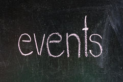 Events. Handwritten with white chalk on a blackboard royalty free stock image