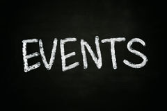 Events Concept. The word events written with chalk on blackboard stock images