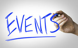 Events hand writing on blue marker on transparent wipe board.  royalty free stock photography