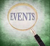 Events magnify. By 3d rendered magnifying glass on green grunge background Stock Photos