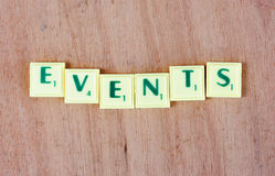 Events. A set of letter game blocks with points forming the word events stock image