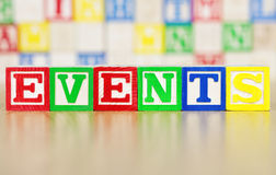 Events Spelled Out in Alphabet Building Blocks Stock Images