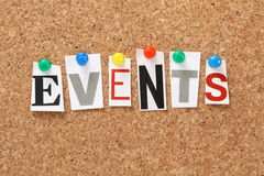 Events. The word Events in cut out magazine letters pinned to a cork notice board. Events may refer to news and current affairs, special occasions or Stock Photography