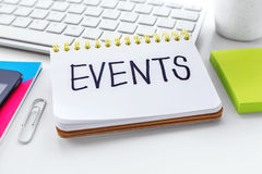 Events word on notebook. With computer keyboard for event planning concept stock photos