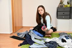 Eventually I must tidy up my room, frustrated teenage girl choosing her outfit royalty free stock images