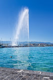 The ever spouting large fountain called Jet d`Eau, Geneva, Switzerland. GENEVA-JULY 25, 2011. The ever spouting large fountain called Jet d`Eau, one of the city Stock Photography