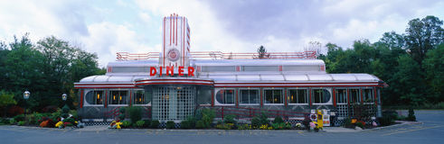 Eveready Diner. This is the Eveready Diner. It is a 50's style diner whose building looks similar to an old train car. The roof is made from a silver chrome with royalty free stock image