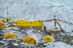 Everest Base Camp tents on Khumbu glacier EBC, Nepal side. Khumbutse overlooks a sprinkling of colored tents EBC, Nepal side. Nepalese south Everest Base Camp Stock Photography