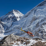 EVEREST BASE CAMP TREK/NEPAL - OCTOBER 31, 2015. EVEREST BASE CAMP TREK/NEPAL - OCTOBER 31, 2015: Rescue helicopter in high Himalayan mountains. Red rescue Royalty Free Stock Photo