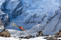 EVEREST BASE CAMP TREK/NEPAL - OCTOBER 31, 2015. EVEREST BASE CAMP TREK/NEPAL - OCTOBER 31, 2015: Rescue helicopter in high Himalayan mountains. Red rescue Stock Photo