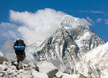 Everest from Gokyo ri with tourist. Evening view of Everest from Gokyo ri with tourist on the way to Everest base camp - Nepal Stock Photos