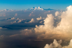 Everest mount view from plane. The Everest mount aerial view from plane over cloud sea before landing in Kathmandu in Nepal royalty free stock photography