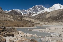 Everest mountain peak behind freezing lake, Mera region, Nepal Stock Photo