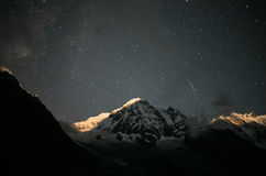 Everest mountain among stars Royalty Free Stock Images