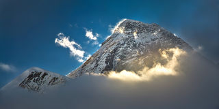 Everest. The peak of the highest mountain in the world - Mt. Everest in the light of the first sunrays stock images