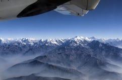Everest Peak and Himalaya Everest mountain range panorama view through plane window Stock Photography