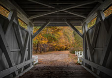 Everett Road Covered Bridge. Looking out at the beautiful fall colors from the inside of the Everett Road Covered Bridge in the Cuyahoga Valley National Park in Stock Photography