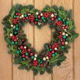 evergreen украшения рождества цветет вал красного цвета poinsettia приветствиям стоковые фото