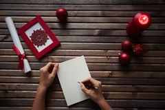 evergreen украшения рождества цветет вал красного цвета poinsettia приветствиям стоковые фотографии rf