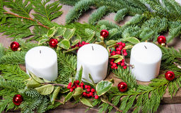 Evergreen Christmas centerpiece with candles Stock Image