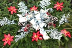Evergreen Christmas decoration with Poinsettias stock photo