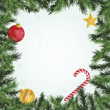 Evergreen Christmas Ornament Border. Square border design with Christmas ornaments and evergreen branches around pale green gradient copy space Stock Photo