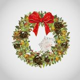 Christmas wreath with apples cones holly and bow. Evergreen christmas wreath with apples cones holly and bow Royalty Free Stock Photo
