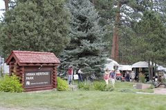 Evergreen, Colorado Fine Arts Festival. Evergreen, CO, USA - August 26, 2017: Evergreen Fine Arts Festival in Hiwan Homestead's Grove. People enjoying the Royalty Free Stock Image