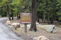 Echo Lake Picnic Area Sign. Evergreen, CO, USA - August 24, 2017: Small square sign at Echo Lake Picnic area listing restrictions and hours. Rules of Echo Lake stock images
