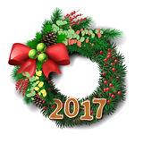 Evergreen holiday wreath with gingerbread number of 2017 year. Christmas Wreath. Evergreen holiday wreath with bow and red berries and gingerbread number of 2017 Royalty Free Stock Photography