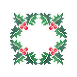 Evergreen holly with berries. Christmas frame. Royalty Free Stock Photography