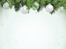 Evergreen with Silver Ornaments. Evergreen branches with silver ornaments hanging from top. Copy space with faint snowflake and snow dot pattern Royalty Free Stock Photography