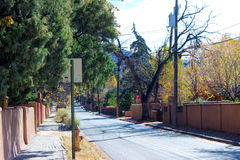 Evergreens Line the Street. At autumn in Santa Fe Stock Images