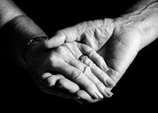 Everlasting love. Picture of a Mature couple holding hands stock photo