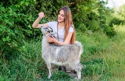 Every animal is different. woman vet feeding goat. farm and farming concept. Animals are our friends. happy girl love