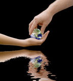 Every childs inheritance. An image depicting a father passing the world to his offspring, the concept being our children inherit the world, with flood water royalty free stock photography